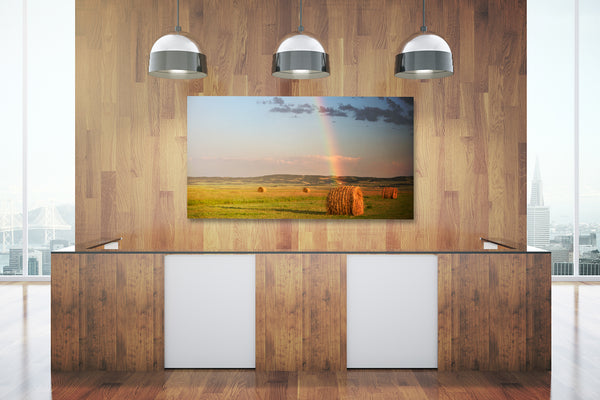 Big canvas print of bales of hay on display in a modern office.