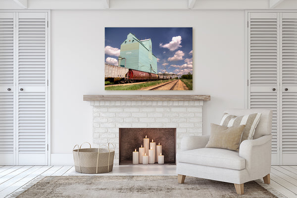 Canvas print of Grain Elevator in Legal hanging in living room with a fireplace.