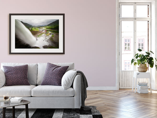 Framed waterfall print hanging on urban walls of modern metropolitan home.