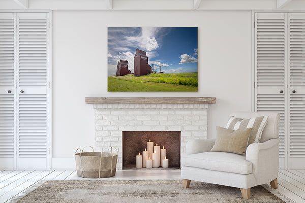Canvas print of Rowley hanging on the mantle of a fireplace.