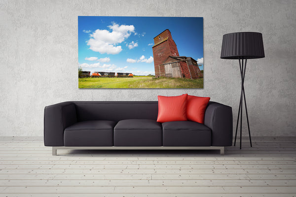Big canvas of CN train passing Alberta grain elevator on display in modern living room.