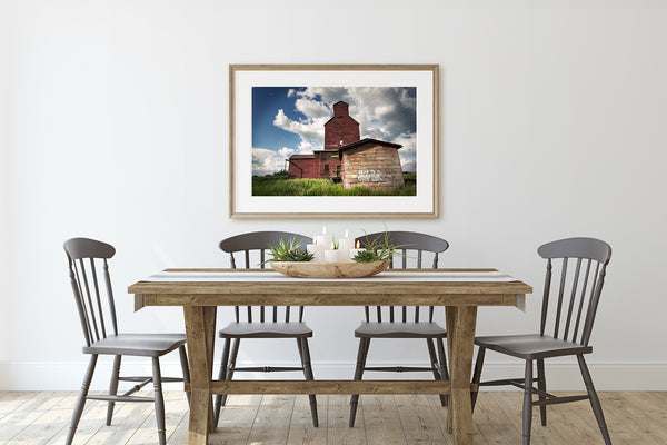 Picture of Grain Elevator hanging above rustic modern dining table.