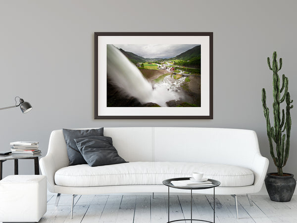 Framed waterfall print hanging in a modern living room. Condo decor ideas.