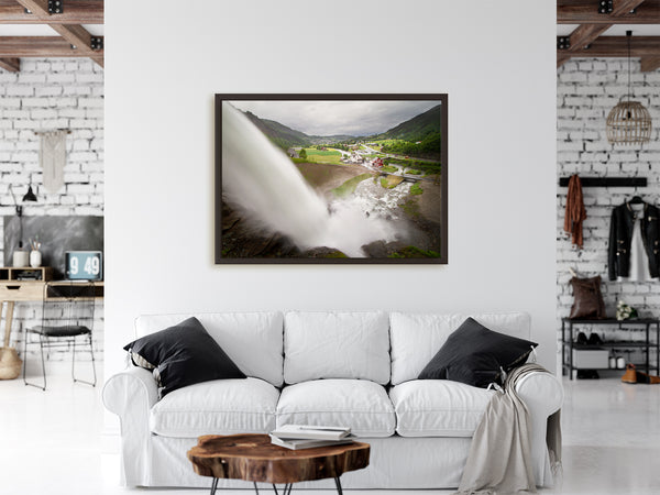 Framed waterfall print hanging on urban walls of a Norweigan apartment.