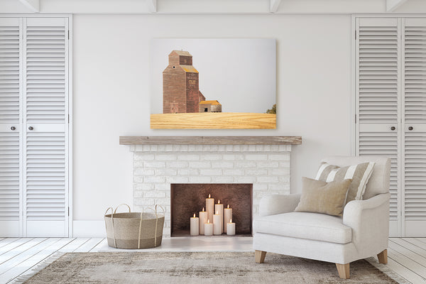 Canvas print of Warwick Grain Elevator hanging above mantle of fireplace. Rustic Modern Living Room decor.