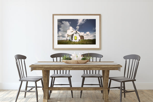 Print of Grain elevator in wooden frame on display in Rustic Modern Dining Room.