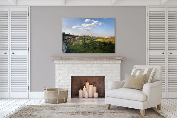 Print of Edmonton River Valley on display in a cozy living room with  a fireplace.