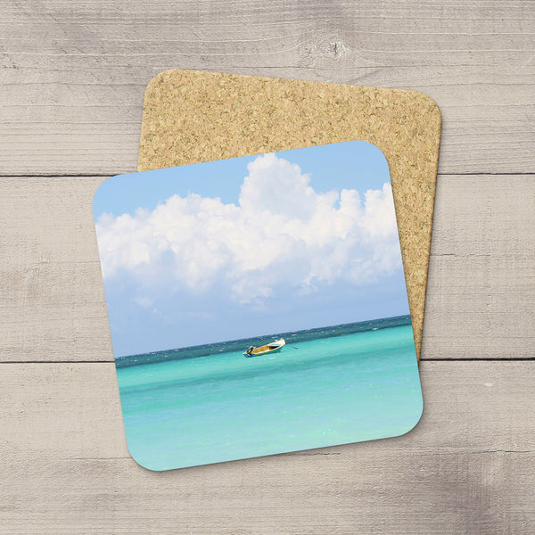 Photo Coasters of a boat drifting on Caribbean Sea in Jamaica. Souvenirs & home accessories. Handmade in Edmonton, Alberta by Canadian photographer & artist Larry Jang.