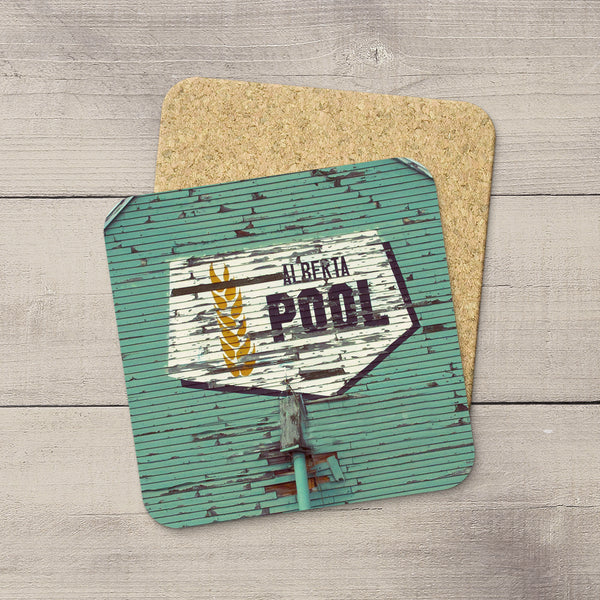 Photo coasters of iconic Alberta Wheat Pool logo taken from the side of a grain elevator by Larry Jang.