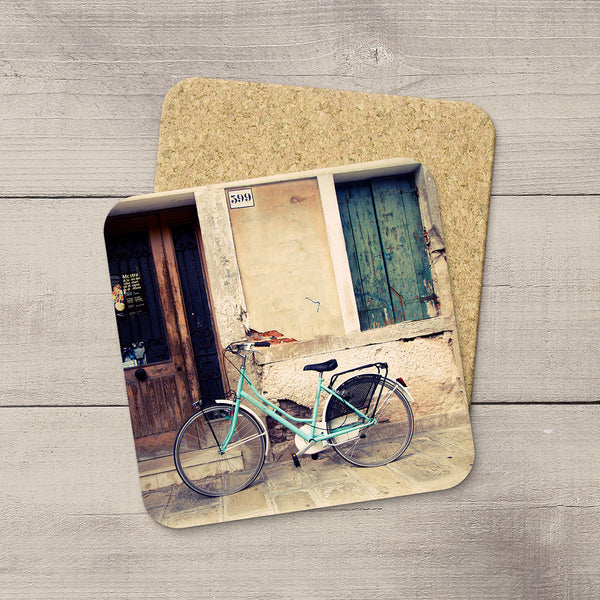 Table coasters featuring a photo of an aquamarine colored bicycle in Italy by Larry Jang