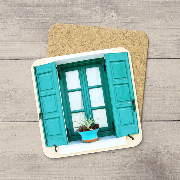 Photo coaster of an aquamarine window & shutters  from Santorini, Greece by travel photographer Larry Jang