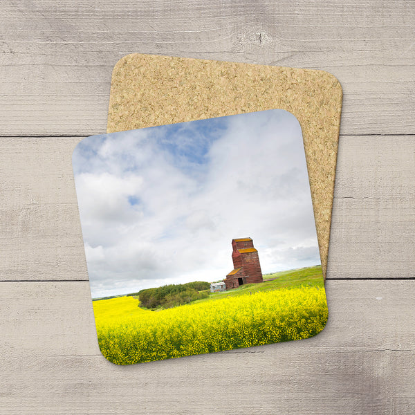 Photo coasters of a canola field and Grain Elevator in Canadian Prairies by Larry Jang.