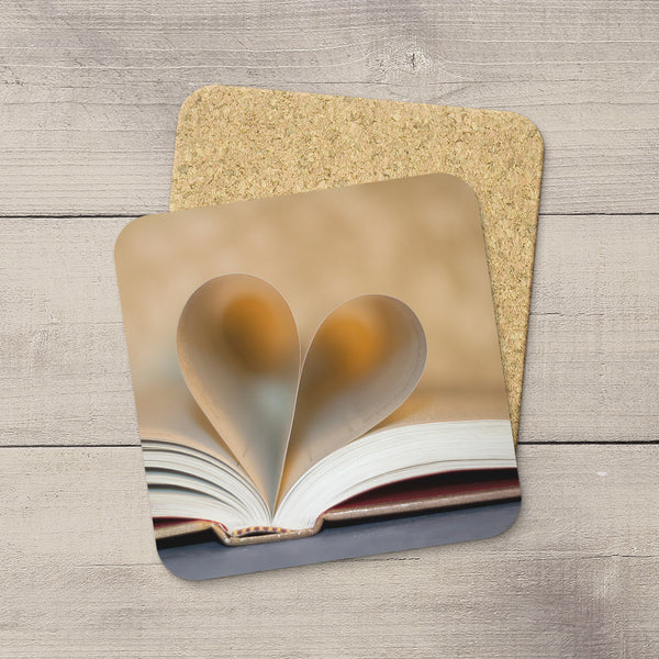 Library Accessories. Photo Coasters of pages folded into a heart. Book of Love.  Modern functional art by Edmonton artist & photographer Larry Jang.