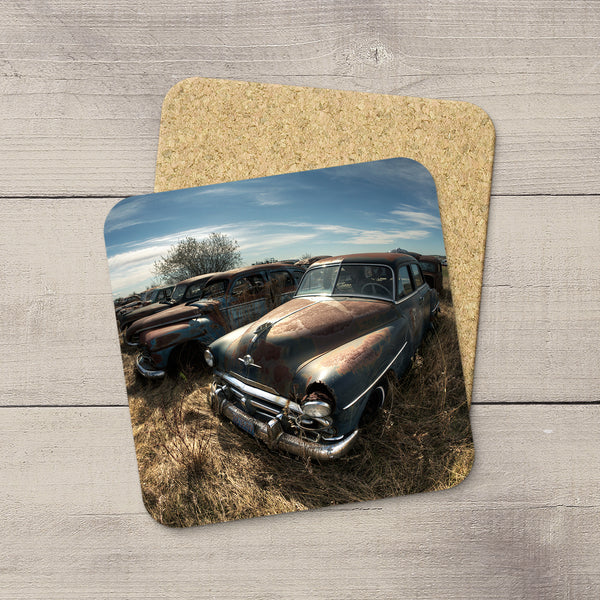 Drink coasters featuring a field of rusty vintage cars by acclaimed Canadian Photographer Larry Jang.