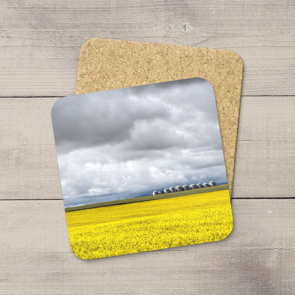 Photo Coasters of Grain silos in Canola field under storm clouds. Souvenirs of Canadian Prairies. Handmade in Edmonton, Alberta by Canadian photographer & artist Larry Jang.