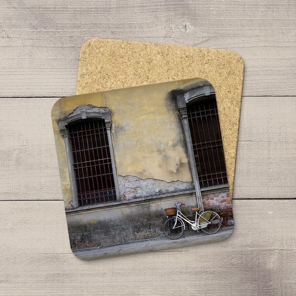 Photo coasters of a bicycle against a charming wall in Lucca Italy by Larry Jang