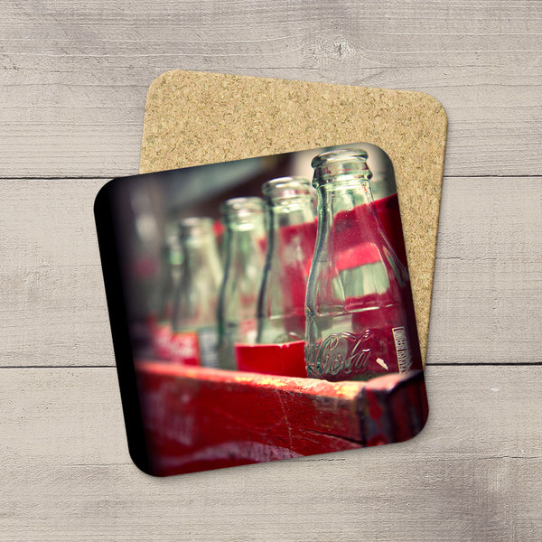Kitchen Accessories. Photo Coasters of Vintage Coca Cola bottles and wooden crate. Modern functional table decor by Edmonton artist & photographer.