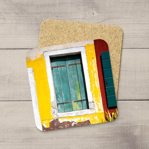 Home accessories. Coasters of a window from colorful houses in Burano Italy by travel photographer Larry Jang.