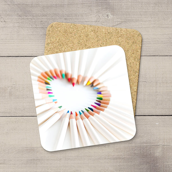 Craft Room Decor Ideas. Photo Coaster of Pencil Crayons in shape of a heart. Modern functional table decor by Edmonton artist & photographer.
