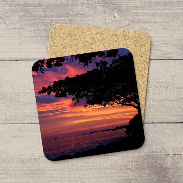 Photo Coasters of a beautiful Hawaiian sunset framed by a Koa tree in Kona, Big Island, USA. Souvenirs & travel themed home accessories. Handmade in Edmonton, Alberta by Canadian photographer & artist Larry Jang.