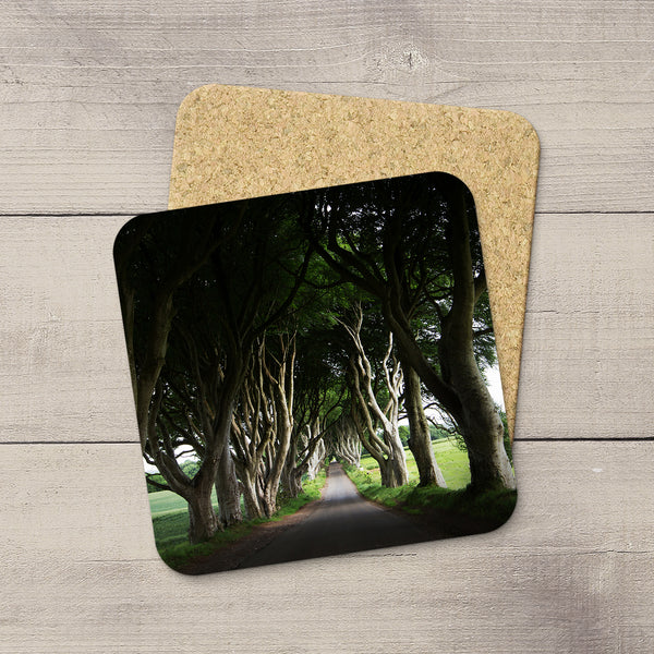 Coasters featuring the avenue of beech trees known as The Dark Hedges along Bregagh Road between Armoy and Stranocum in County Antrim, Ireland. Souvenirs & travel themed home accessories. Handmade in Edmonton, Alberta by Canadian photographer & artist Larry Jang.