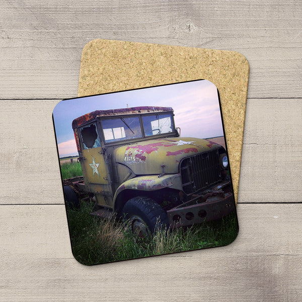 Photo of a decommissioned US Army truck sitting in a field printed onto drink coasters by Larry Jang.