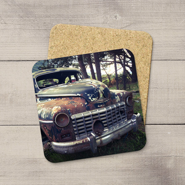 Dodge truck sitting in a field in Norway. Photo coaster hand printed by Christina Jang.