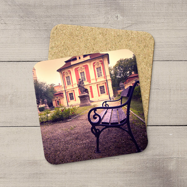 Photo of a park bench in Dvorak's garden in Prague, Czech Republic printed on beverage coasters by Larry Jang.