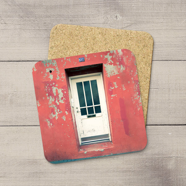 Cork photo coasters of White door on salmon colored wall from Reykjavik Iceland by Travel Photographer Larry Jang