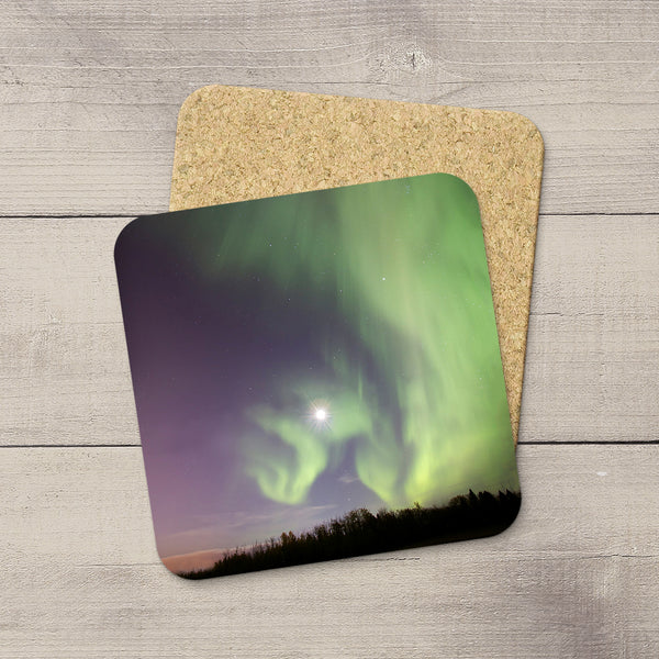 Photo Coasters of Northern Lights dancing around & framing the moon. Souvenirs of Aurora Borealis by Canadian Photographer, Larry Jang.