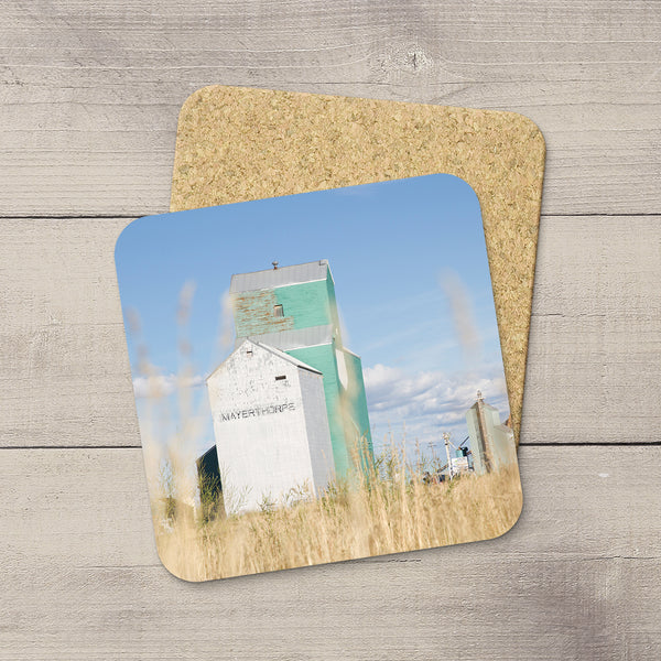 Cork Coasters of Mayerthorpe grain elevator as seen through wild prairie grass by Larry Jang.
