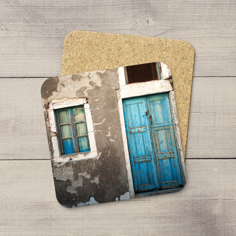 Photo coasters of a weathered wooden door in Oia Santorini Greece by Travel Photographer Larry Jang.