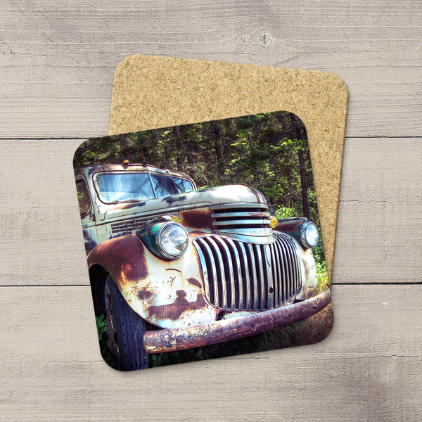 Grinning rusty Chevy Truck in Montana. Drink Coasters by acclaimed Canadian Photographer Larry Jang.