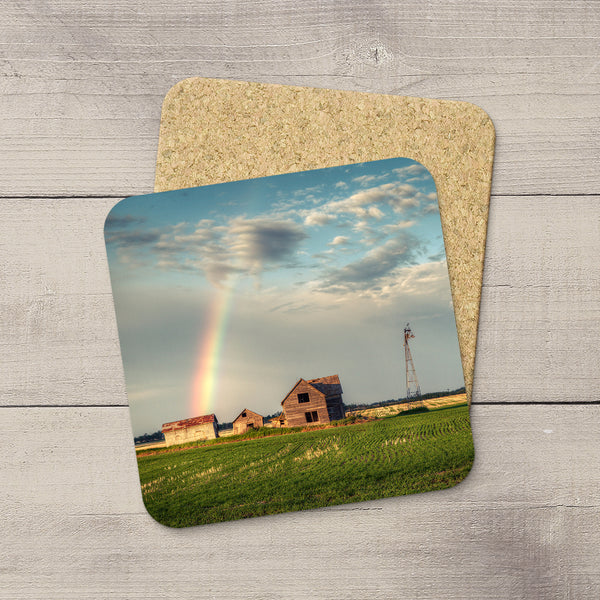 Drink Coasters of an abandoned farm with a rainbow of hope arcing into it. Prairie love themed table art by Larry Jang.