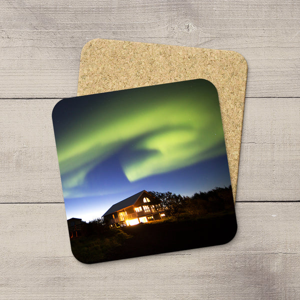Photo Coasters of Northern Lights curving over a house in Iceland. Souvenirs of Aurora Borealis by Canadian Photographer, Larry Jang.