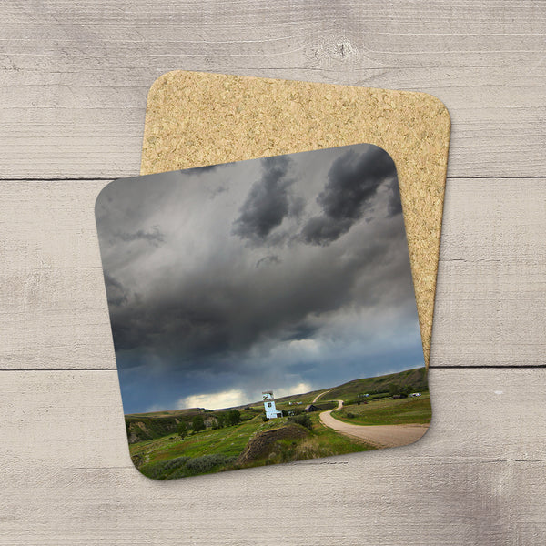 Drink Coasters of prairie road leading straight into a summer storm near Carbon Alberta  by Edmonton based photographer, Larry Jang.