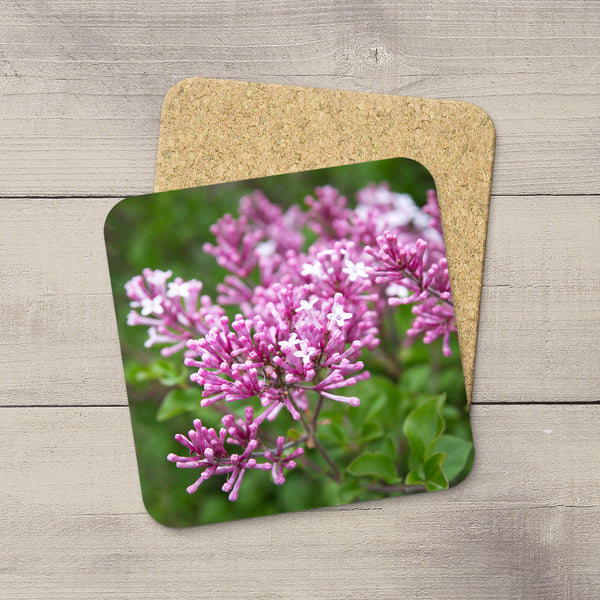 Image of lilac flowers hand printed on drink coasters by Edmonton photographer Larry Jang.