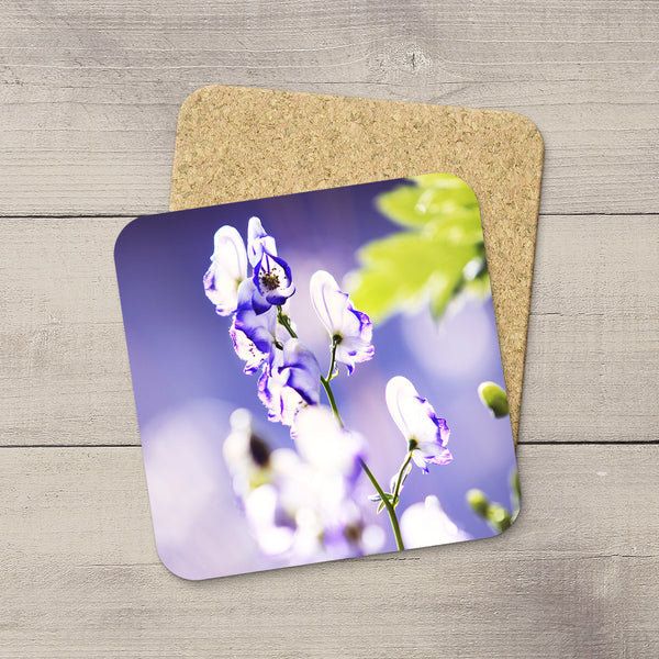 Image of Monkshood flowers printed on coasters by Edmonton photographer Larry Jang.