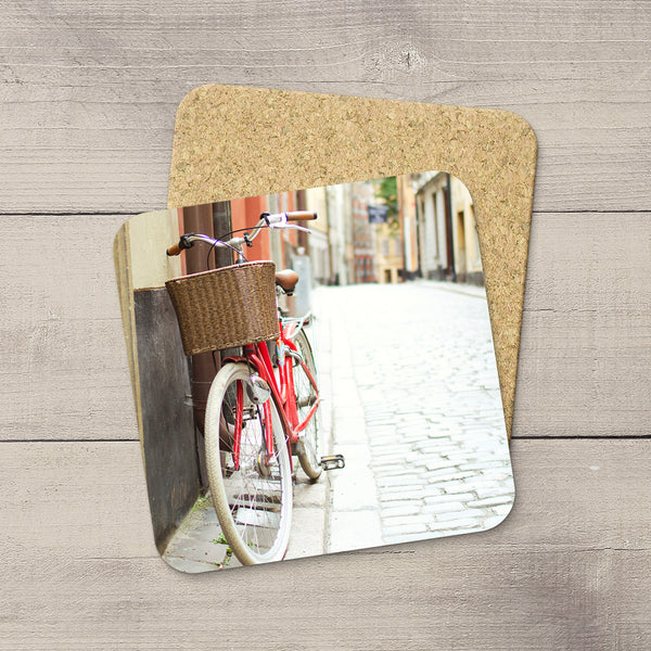 Home Accessories. Drink Coasters of a red bike & basket parked in Gamla Stan in Stockholm, Sweden by Larry Jang
