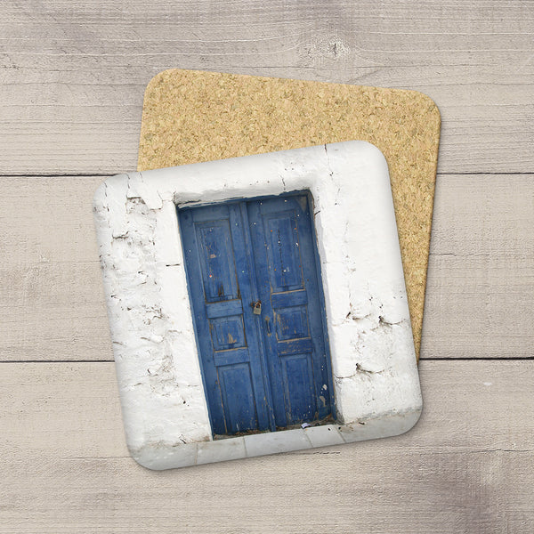 Home accessories. Cork coasters of an Indigo Blue door in Santorini, Greece by Travel photographer Christina Jang.