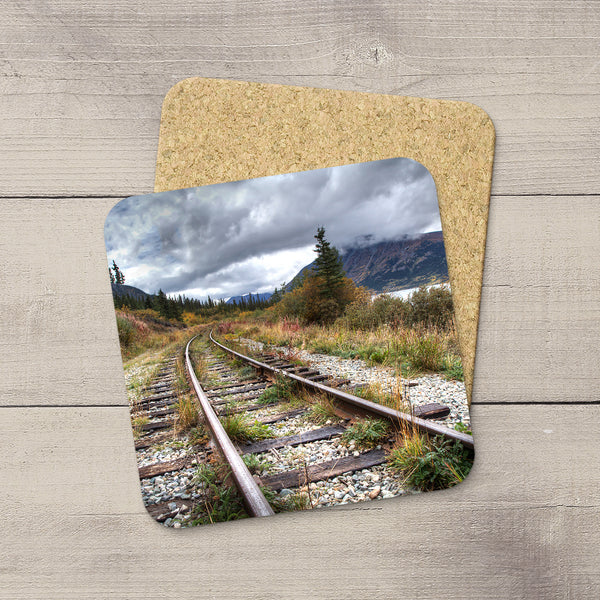 Drink Coasters of Railroad Tracks in mountains of Yukon Territory, Canada.  Souvenirs of Carcross. Handmade in Edmonton, Alberta by Canadian photographer & artist Larry Jang.