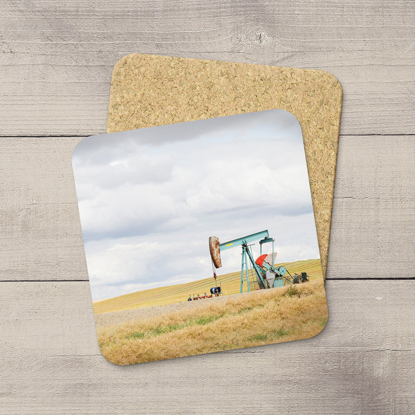 Drink Coasters of an aquamarine oil pump jack in Southern Alberta. Home accessories by Larry Jang