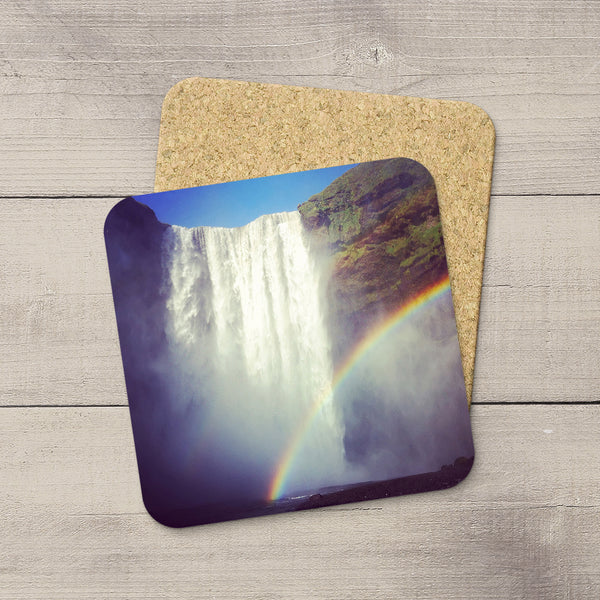 Photo Coasters of a rainbow at Skogafoss waterfall in Iceland. Souvenirs & travel themed home accessories. Handmade in Edmonton, Alberta by Canadian photographer & artist Christina Jang.