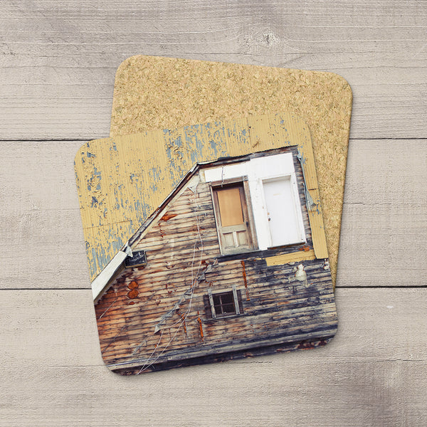 Photo coasters of a ramshackle door on an abandoned building in Yukon. Home accessories by Edmonton based photographer & artist, Larry Jang