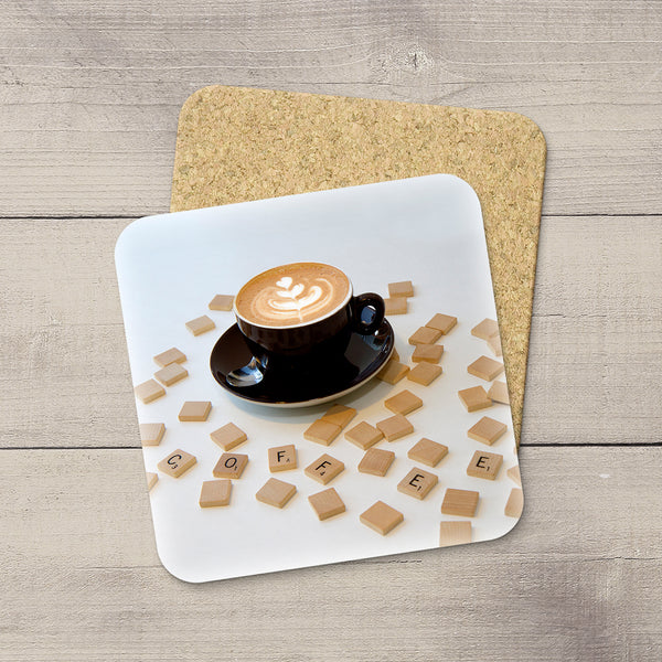 Kitchen decor ideas. Photo Coasters of a random Scrabble Tiles spelling COFFEE. Modern functional table decor by Edmonton artist & photographer.