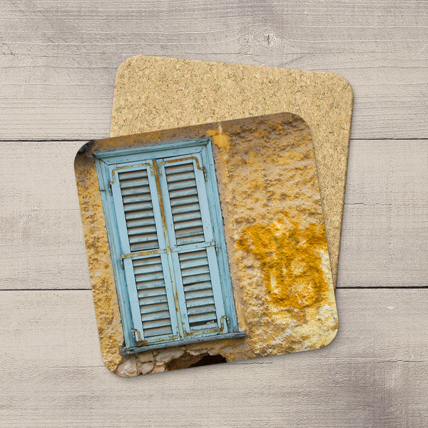 Photo Coasters of a Aquamarine window and shutters on a wall of graffiti in Athens Greece by Travel Photographer Larry Jang.