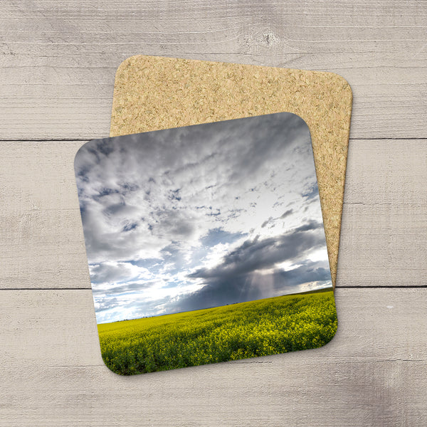 Photo Coasters of sun rays breaking through storm clouds and beaming down onto the Canola fields of Southern Alberta.  Souvenirs of Canadian Prairies. Handmade in Edmonton, Canada by Canadian photographer & artist Larry Jang.