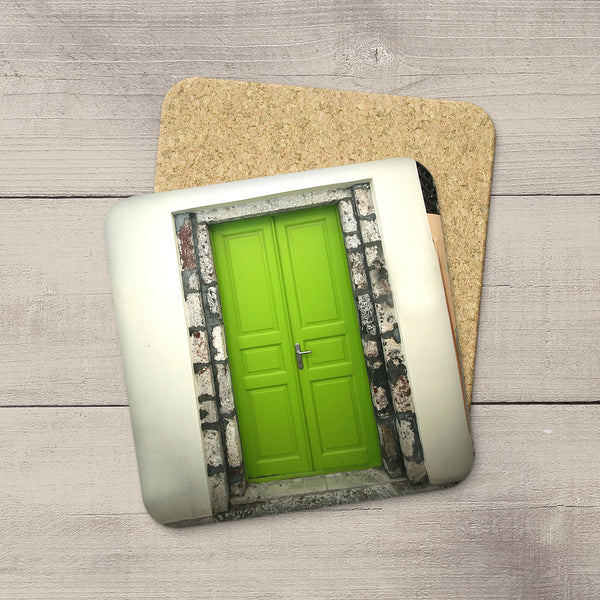 Tabletop decor. Photo coasters of a lime green door in Santorini Greece by Travel Photographer Larry Jang.