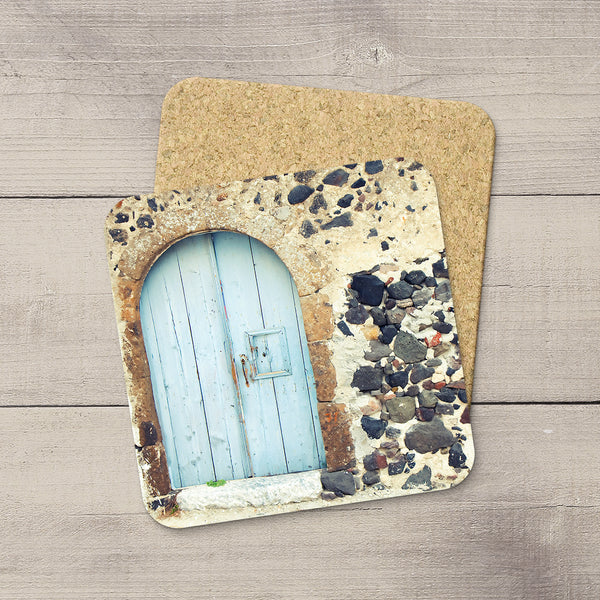 Travel themed decor. Coasters of a baby blue wooden door in Santorini Greece hand printed by larry Jang.