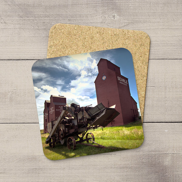 Photo coasters featuring Rowley Grain Elevators and vintage thresher by Larry Jang.